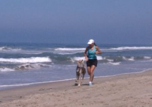 Mary and her dog run on the beach every morning